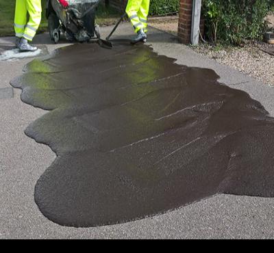 Image showing slurry sealing taking place